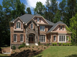 Model Luxury Home Exterior front view sloping yard